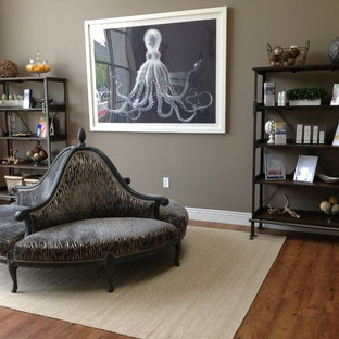 Example of a transitional living room design in Denver