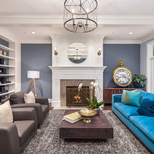 Living room - large traditional formal and enclosed dark wood floor and brown floor living room idea in Seattle with blue walls, a standard fireplace and a stone fireplace