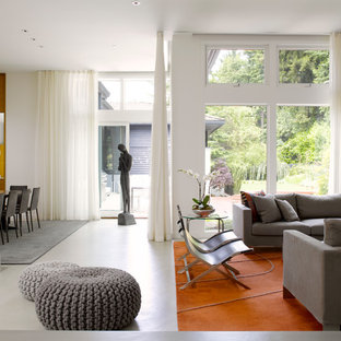 inspiration for a contemporary open concept concrete floor living room remodel in seattle with white walls - Floor To Ceiling Curtains