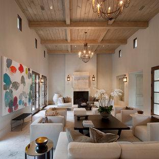 Idée de décoration pour un très grand salon méditerranéen fermé avec une salle de réception, un mur beige, une cheminée standard, aucun téléviseur et un sol en travertin.