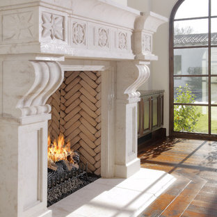 Inspiration for a mediterranean living room remodel in Phoenix with a standard fireplace