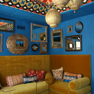 Example of a tuscan living room design in Phoenix with blue walls