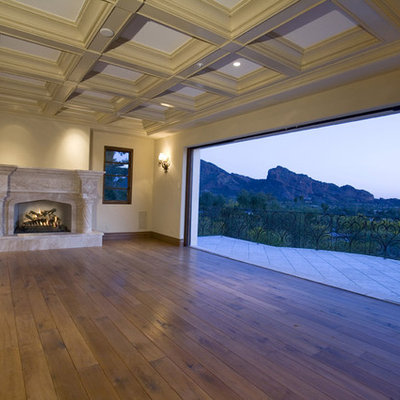 Tuscan living room photo in Phoenix with a standard fireplace