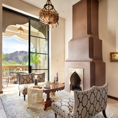 Living room - mediterranean living room idea in Other with beige walls and a standard fireplace