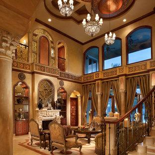 Imagen de salón para visitas abierto, mediterráneo, extra grande, sin televisor, con paredes marrones, chimenea tradicional, suelo de baldosas de porcelana, marco de chimenea de yeso y suelo beige