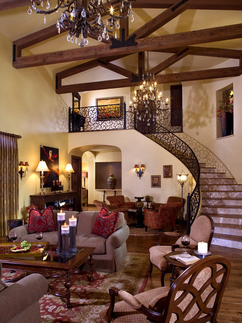 Example Of A Huge Tuscan Living Room Design In Phoenix With Beige Walls