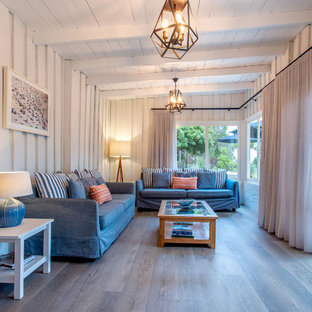 Photo of a beach style living room in Perth with white walls, light hardwood floors and beige floor.