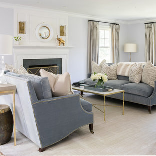 Example Of A Classic Formal Living Room Design In New York With Gray Walls  And A