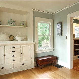 Inspiration for a medium tone wood floor living room remodel in Portland