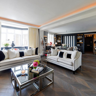 Photo of an eclectic formal open plan living room in London with white walls, dark hardwood flooring and brown floors.