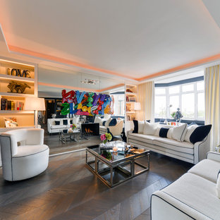 Inspiration for a medium sized modern living room in London with white walls, a ribbon fireplace and brown floors.