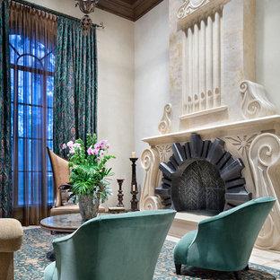 ヒューストンの巨大な地中海スタイルのおしゃれな独立型リビング (フォーマル、横長型暖炉、石材の暖炉まわり、テレビなし) の写真