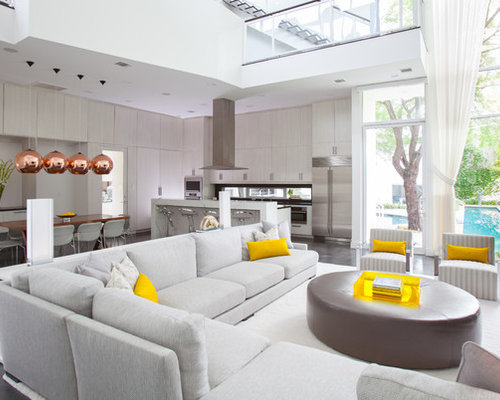 Inspiration For A Contemporary Open Concept Concrete Floor Living Room Remodel In Houston