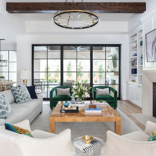 Example of a huge transitional open concept light wood floor, exposed beam and wall paneling living room design in Houston with white walls, a standard fireplace, a stone fireplace and a wall-mounted tv