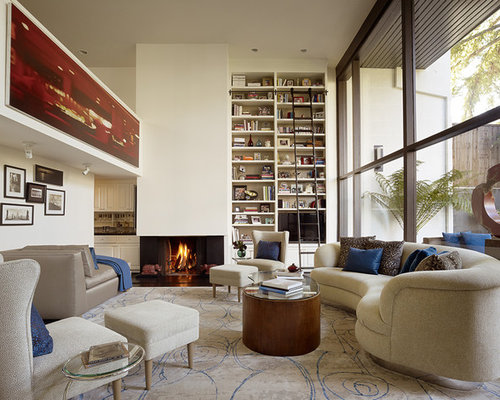 Example Of A Large Trendy Living Room Design In San Francisco With Library