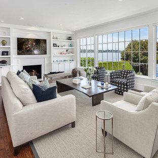 シアトルの大きいビーチスタイルのおしゃれなLDK (フォーマル、グレーの壁、濃色無垢フローリング、標準型暖炉、石材の暖炉まわり、テレビなし、茶色い床) の写真