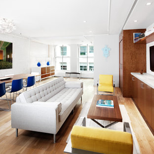 Example of a minimalist living room design in New York with white walls