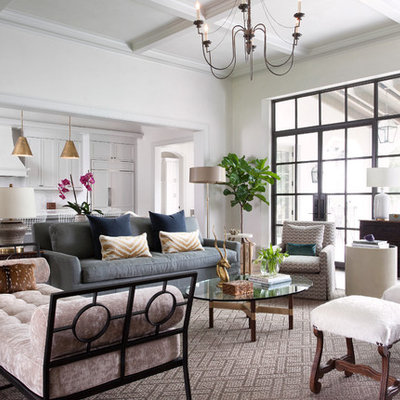 Example of a transitional formal and open concept living room design in Austin with white walls