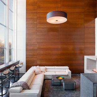 Immagine di un grande soggiorno contemporaneo aperto con pareti bianche, parquet scuro, camino bifacciale, cornice del camino piastrellata e TV a parete