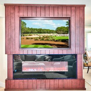 マイアミの大きいビーチスタイルのおしゃれなLDK (ベージュの壁、磁器タイルの床、両方向型暖炉、木材の暖炉まわり、埋込式メディアウォール) の写真
