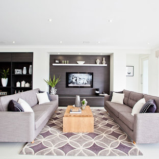 Inspiration for a large contemporary open concept living room in Newcastle - Maitland with grey walls, ceramic floors, no fireplace, a wall-mounted tv and grey floor.