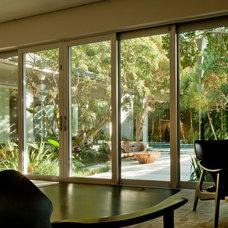 Tropical Living Room by Raymond Jungles, Inc.