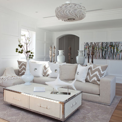 Example of a trendy light wood floor living room design in Miami with white walls