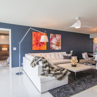 Example of a trendy open concept living room design in Newark with blue walls