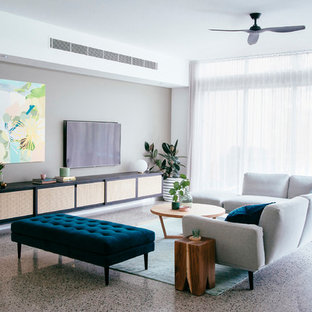 Inspiration for a contemporary enclosed living room in Gold Coast - Tweed with multi-coloured walls and a wall mounted tv.