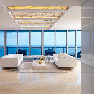マイアミの大きいビーチスタイルのおしゃれなLDK (フォーマル、白い壁、大理石の床、壁掛け型テレビ) の写真