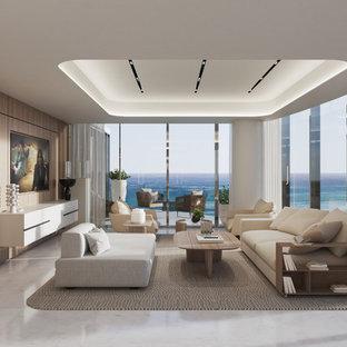 マイアミの大きいビーチスタイルのおしゃれなLDK (フォーマル、白い壁、大理石の床、内蔵型テレビ) の写真
