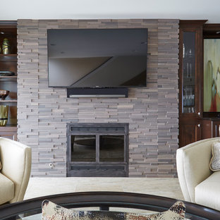 Example of a transitional open concept porcelain tile living room design in Chicago with beige walls, a standard fireplace, a tile fireplace and a wall-mounted tv