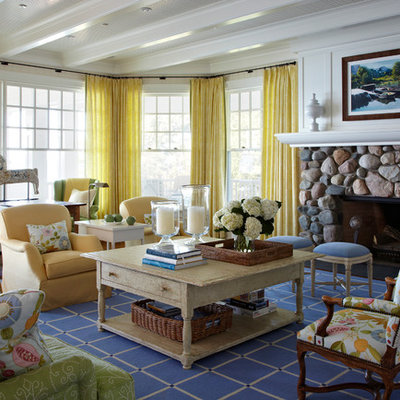 Inspiration for a coastal living room remodel in Chicago with beige walls, a standard fireplace, a stone fireplace and no tv