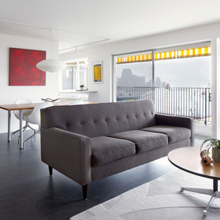 Mid-sized 1950s open concept black floor living room photo in Seattle with white walls and no fireplace
