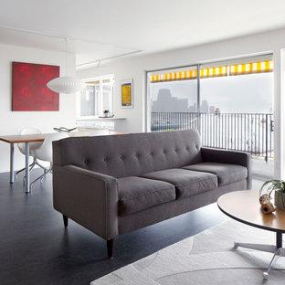 シアトルの中サイズのミッドセンチュリースタイルのおしゃれなLDK (白い壁、暖炉なし、黒い床) の写真