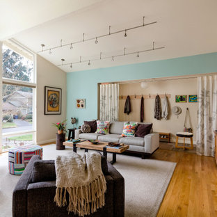 Inspiration for a small 1950s medium tone wood floor and brown floor living room remodel in Seattle with blue walls