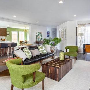 ロサンゼルスの大きいミッドセンチュリースタイルのおしゃれなLDK (白い壁、コンクリートの床、標準型暖炉、タイルの暖炉まわり、壁掛け型テレビ、グレーの床) の写真