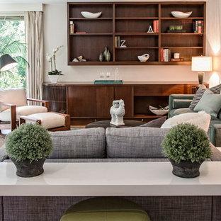 Esempio di un soggiorno moderno di medie dimensioni e aperto con pareti bianche e pavimento in ardesia