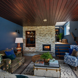 Design ideas for a medium sized eclectic living room in Other with blue walls, light hardwood flooring, a standard fireplace and a brick fireplace surround.