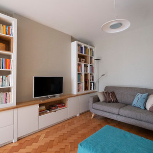 Design ideas for a small midcentury open plan living room in Cardiff with beige walls, light hardwood flooring, a freestanding tv and beige floors.