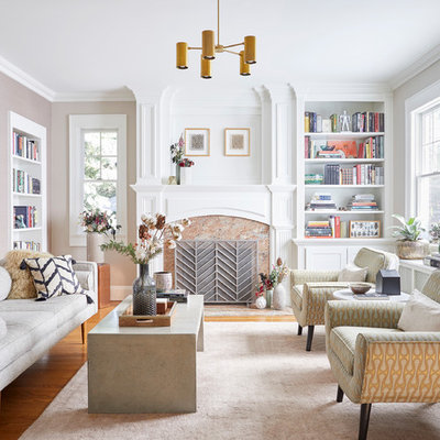 Example of a mid-sized transitional enclosed and formal medium tone wood floor and brown floor living room design in New York with a standard fireplace, a stone fireplace, no tv and beige walls