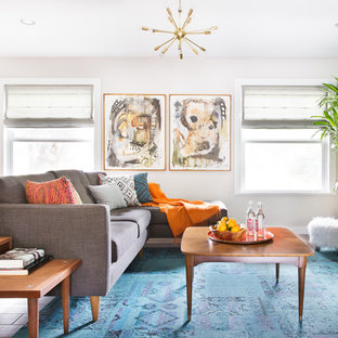 Inspiration for a mid-sized mid-century modern enclosed living room remodel in Austin with gray walls and no fireplace