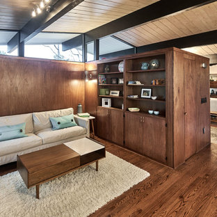 Inspiration for a medium sized midcentury formal open plan living room in San Francisco with brown walls, brown floors, medium hardwood flooring, a standard fireplace, a tiled fireplace surround and no tv.