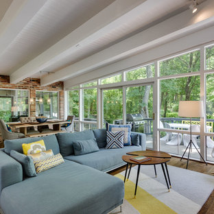 Inspiration for a 1950s medium tone wood floor living room remodel in DC Metro