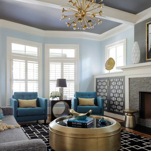 Large transitional enclosed and formal medium tone wood floor living room photo in Atlanta with blue walls, a standard fireplace and a tile fireplace