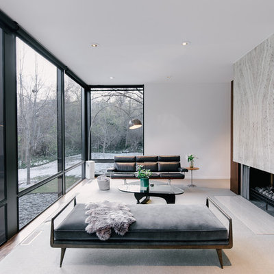 Example of a large minimalist open concept carpeted living room design in Salt Lake City with white walls, a two-sided fireplace, a stone fireplace and no tv