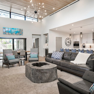 Photo of a traditional open plan living room in Miami with white walls, light hardwood flooring, a standard fireplace, a stone fireplace surround and a wall mounted tv.
