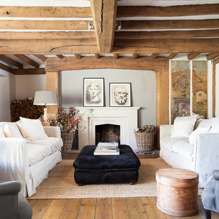 Inspiration for a farmhouse enclosed living room in Kent with a standard fireplace and no tv.