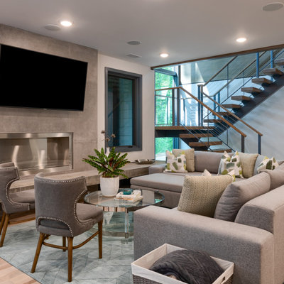 Trendy open concept light wood floor and beige floor living room photo in Other with white walls, a ribbon fireplace, a tile fireplace and a wall-mounted tv