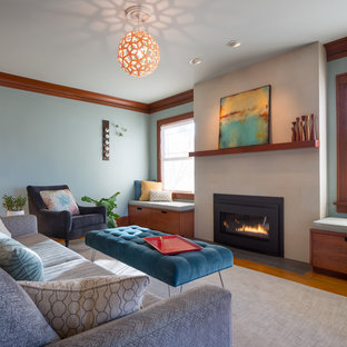 Inspiration for a 1950s formal medium tone wood floor living room remodel in Portland with blue walls, a ribbon fireplace and no tv